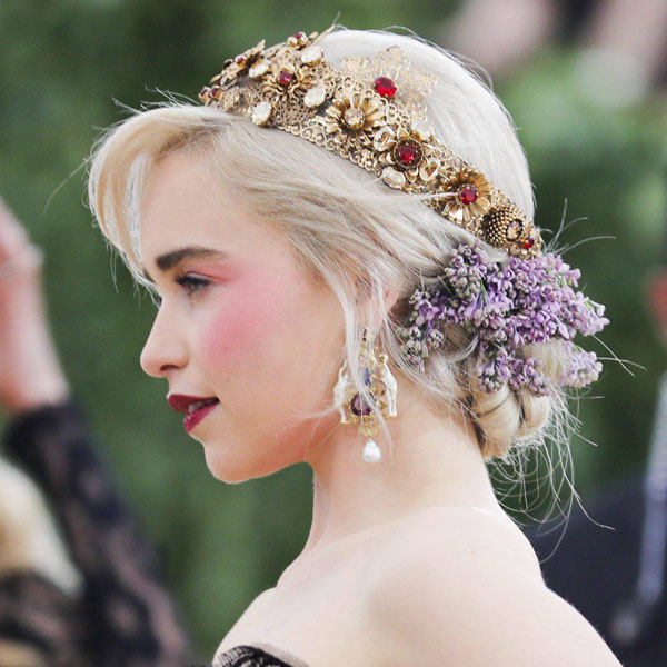 "Actor Emilia Clarke arrives at the Metropolitan Museum of Art Costume Institute Gala (Met Gala) to celebrate the opening of ""Heavenly Bodies: Fashion and the Catholic Imagination"" in the Manhattan borough of New York, U.S., May 7, 2018. REUTERS/Carlo AllegriCODE: X90181